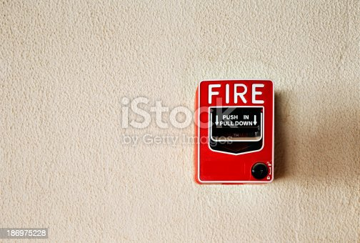 475693130 istock photo Fire alarm button on a wall 186975228