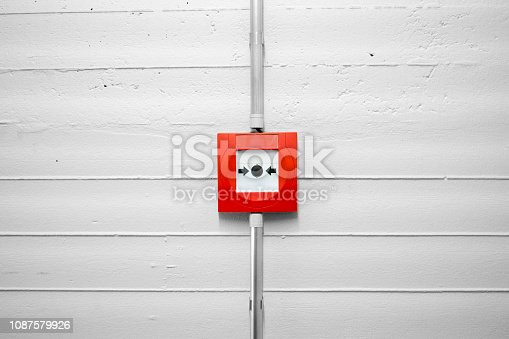 Fire alarm button on the concrete wall