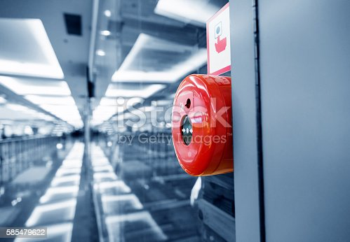 istock Fire alarm button on wall of shopping center 585479622