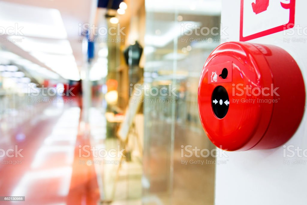 Fire alarm button on wall of shopping center stock photo