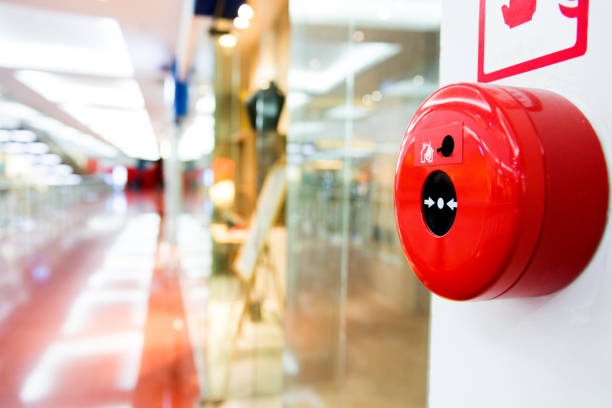 fire alarm button on wall of shopping center - alarm stock pictures, royalty-free photos & images