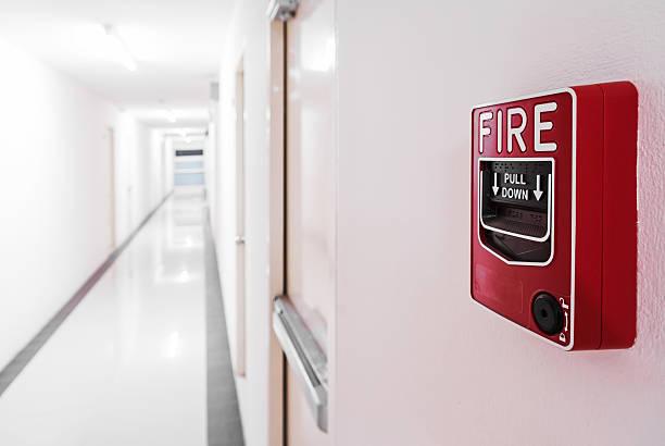 Fire Alarm near door fire exit door stock photo