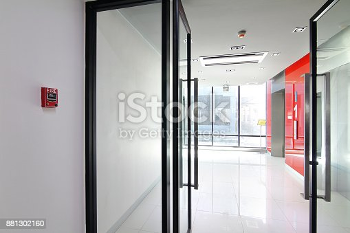 istock Fire alarm near first  floor elevator and emergency exit of the building 881302160