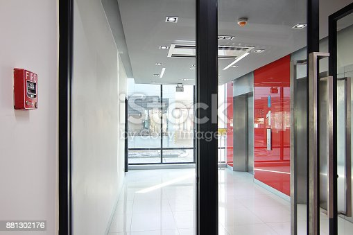 istock Fire alarm near first  floor elevator and emergency exit of the building 881302176