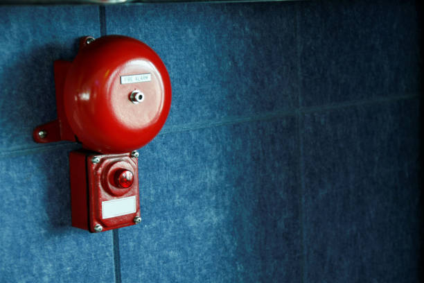 Fire alarm on the wall stock photo