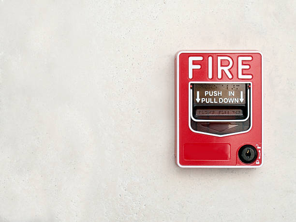 Fire Alarm on white wall stock photo