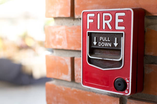 Fire Alarm Signal on Brick wall Fire Alarm Signal on Brick wall drill stock pictures, royalty-free photos & images