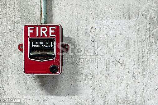 Fire alarm switch on factory wall