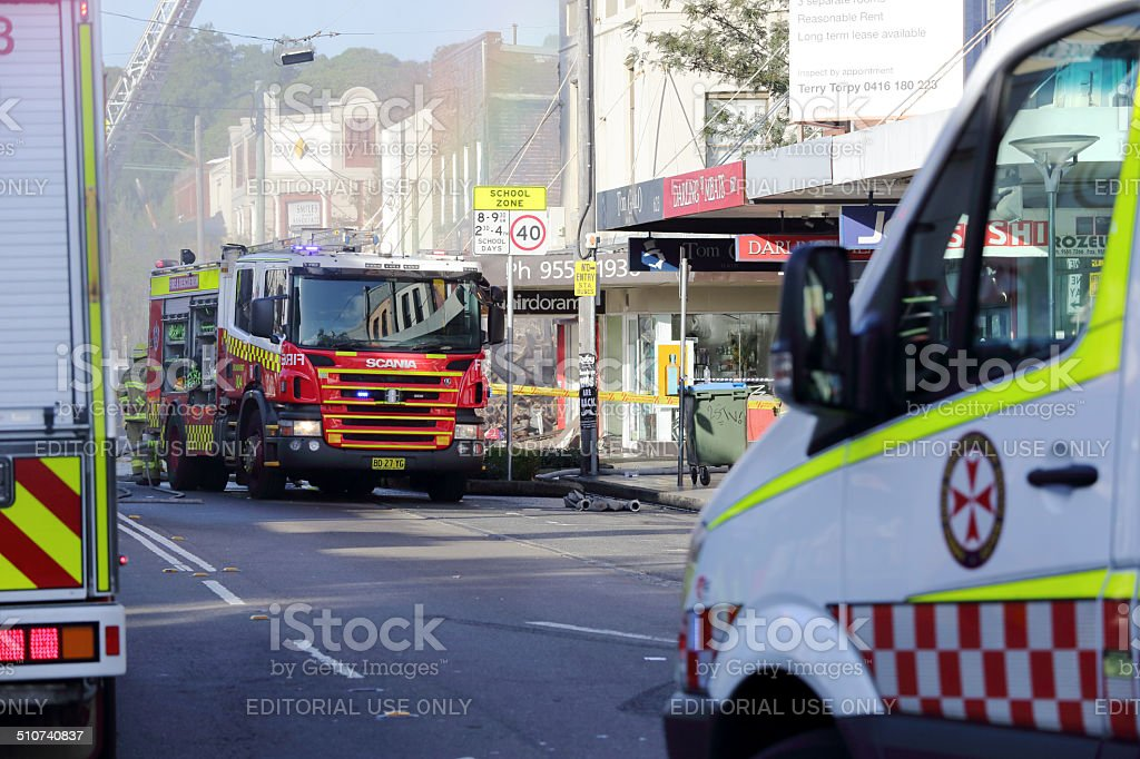 Fire and ambulance crews attend shop blast tragedy stock photo