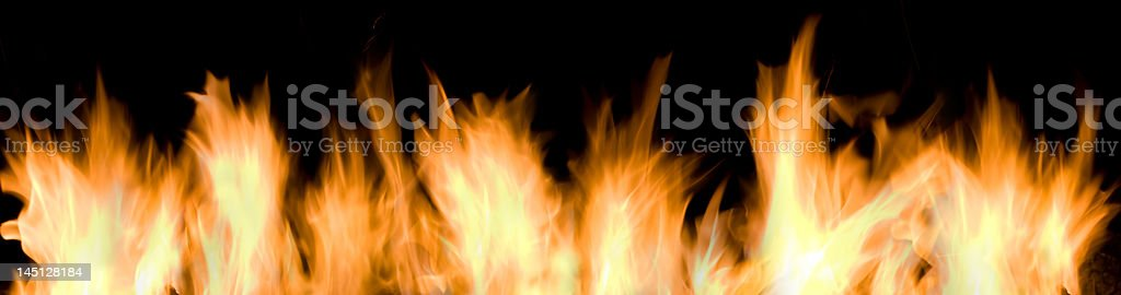 Fire and flames on a black background royalty-free stock photo