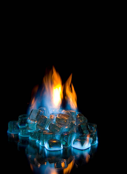 Fire and Ice 2 Flaming ice cubes with reflection on black background. chemical reaction stock pictures, royalty-free photos & images