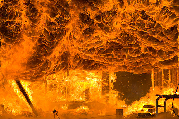 fire and intense flames burns home to the ground - burning stock pictures, royalty-free photos & images