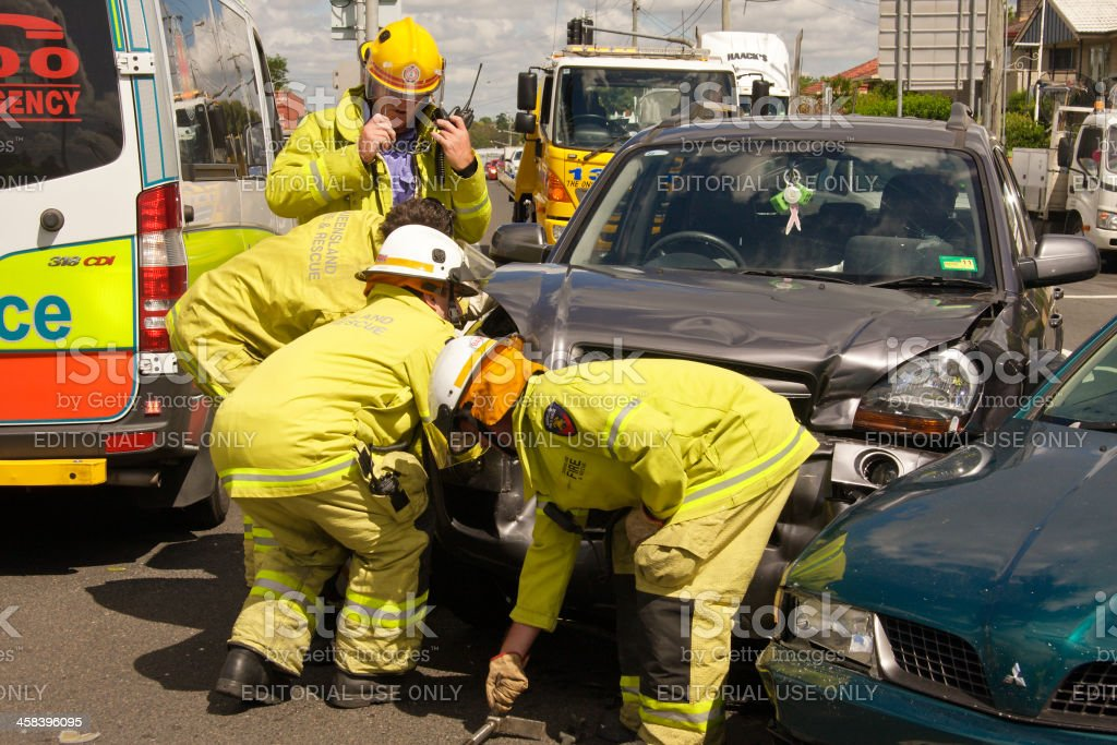 Fire and rescue making a vehicle safe stock photo