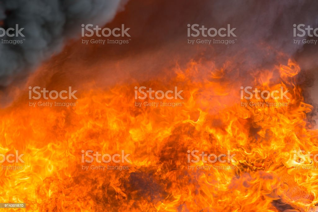 fire and smoke from furniture burning in conflagration stock photo