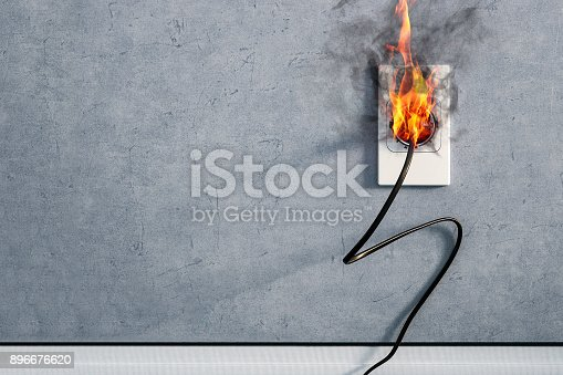 istock fire and smoke on electric wire plug in indoor, electric short circuit causing fire on plug socket 896676620