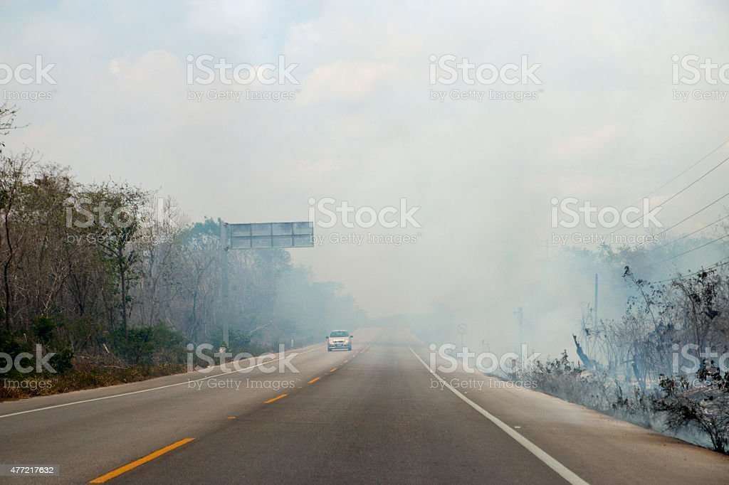 Fire and smoke on the road stock photo