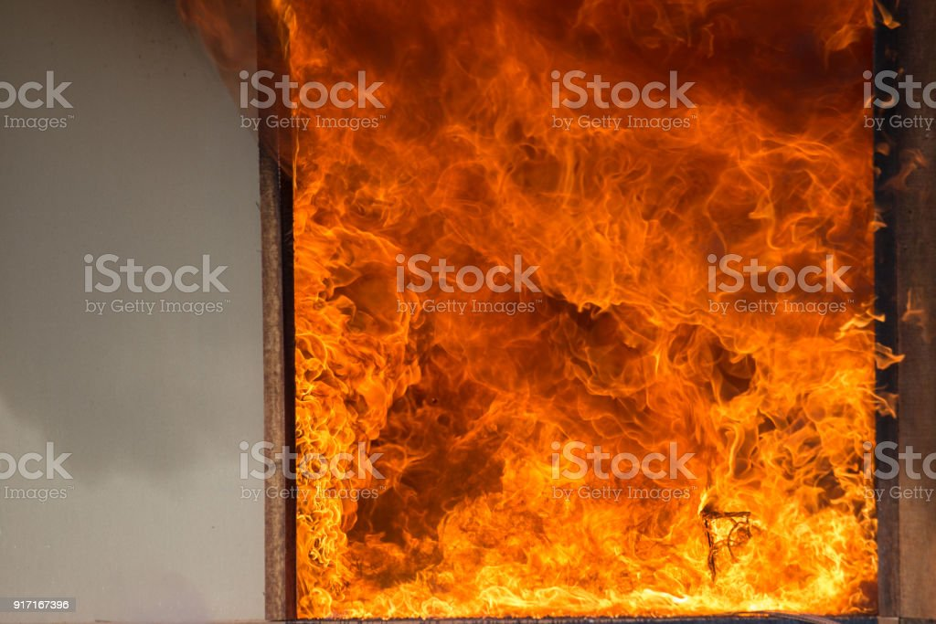 fire and smoke texture from furniture burning at room entrance stock photo