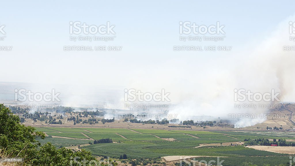 Fire and smoke - war in Syria near Israeli border stock photo