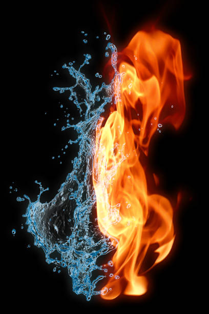 fire and water on a black background. - yin yang symbol stock photos and pictures