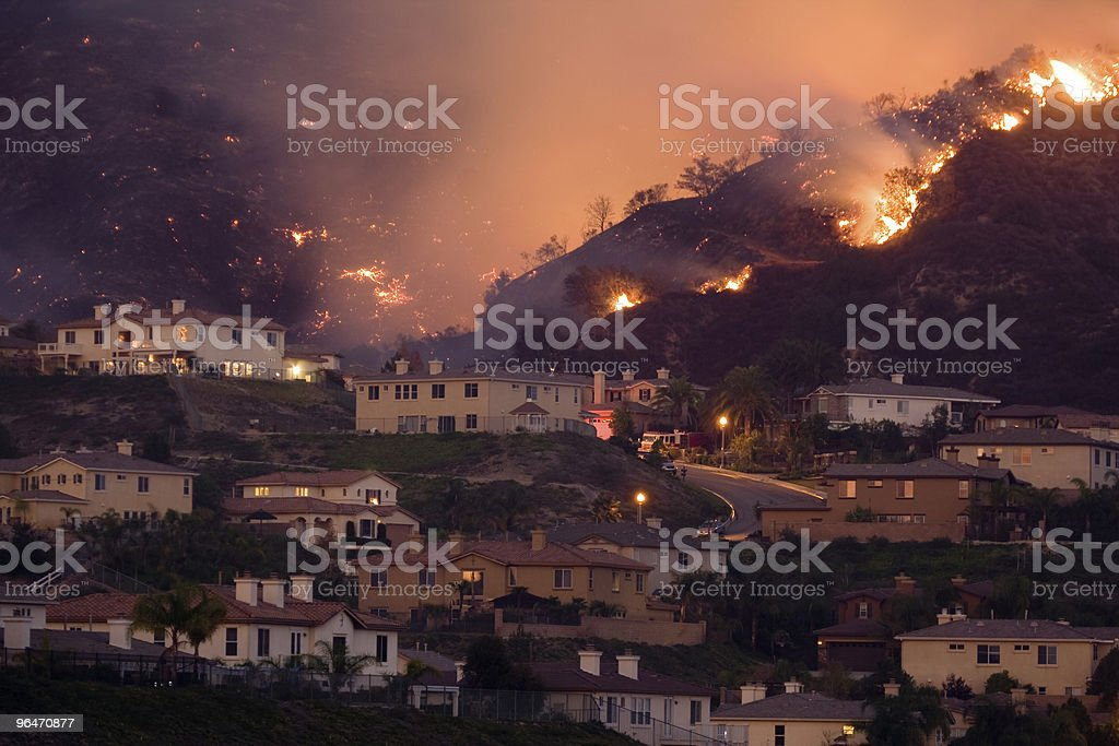 Fire Approaching Homes in California stock photo