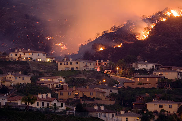 fire approaching homes in california - natural disaster stock pictures, royalty-free photos & images