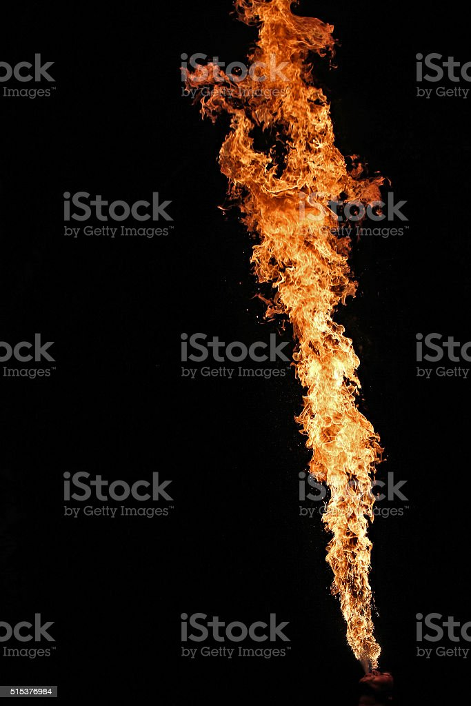 Fire artist performing fire breathing stock photo