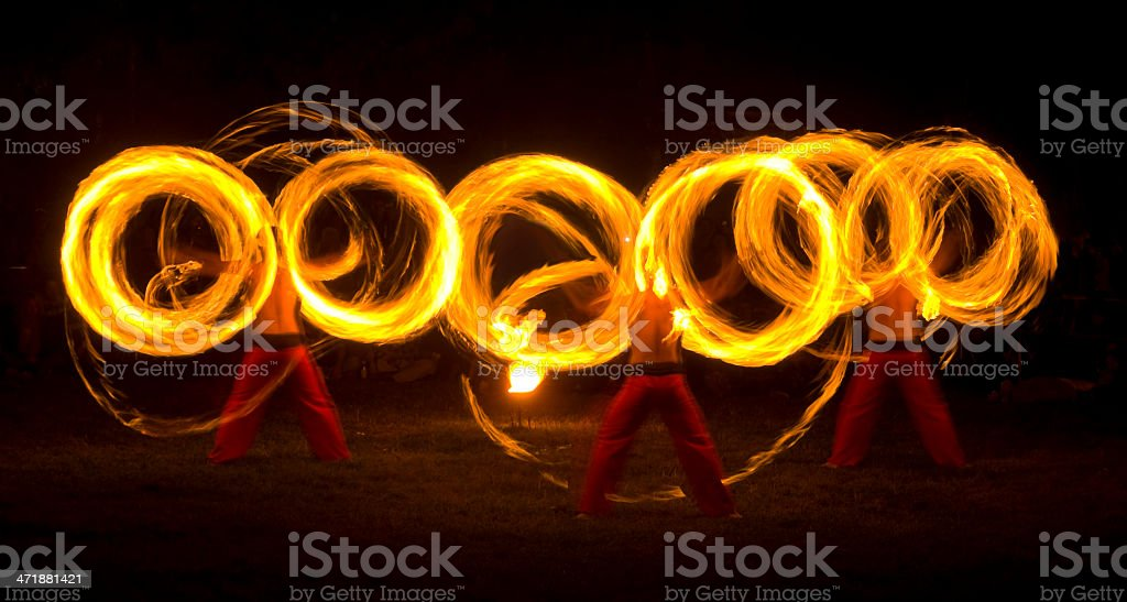 Fire artists make rings of fire stock photo