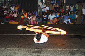 Kandy, Sri Lanka - August 12, 2005:  torchbearer and fire eaters participate the festival Pera Hera in Candy to celebrate the tooth of Buddha. It is an annual event and the highlight of the Sri Lankan religious festivals. The tooth of buddha will be praised by the ceremony.
