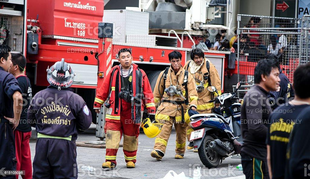 Fire at Robinson Sriracha shopping mall, The fireman walking out stock photo