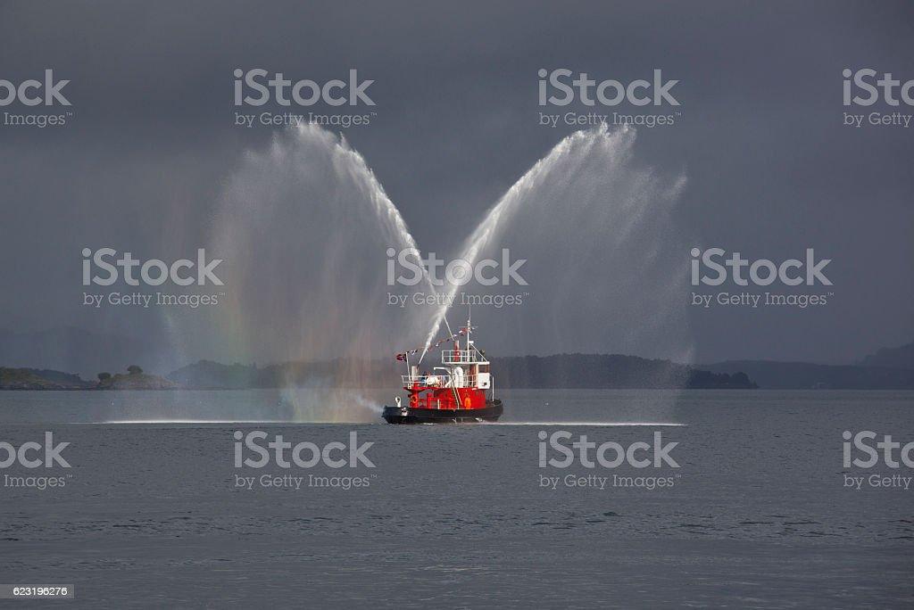 Fire boat makes rainbow salute stock photo