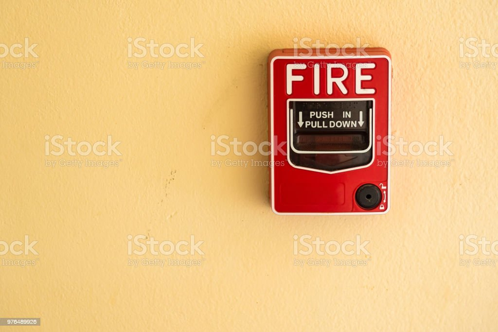 Fire break glass alarm switch on the cement wall