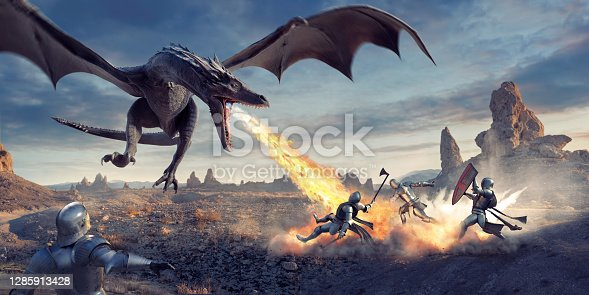 istock Fire Breathing Dragon Flying Low and Attacking Knights In Desert 1285913428