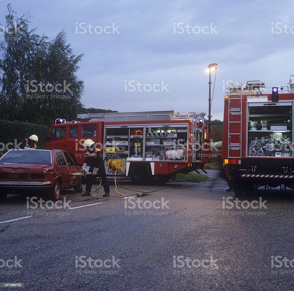 Fire brigade and damaged car royalty-free stock photo