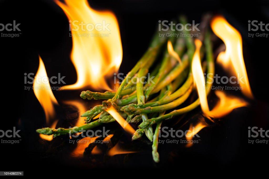 fire-burning-asparagus-on-black-backgrou