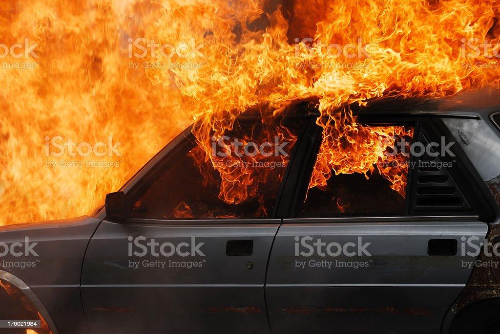 Fire burning car stock photo
