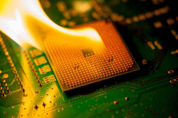 fire Burning cpu on circuit board with electronic stock photo