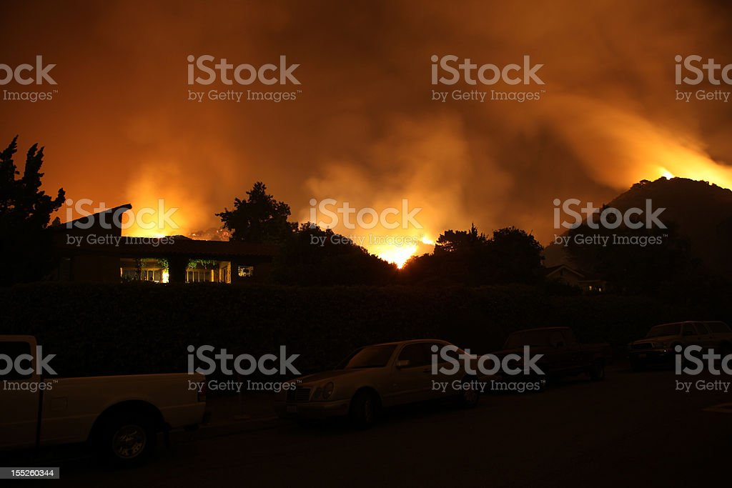 Fire Burning Hillside Silhouette stock photo
