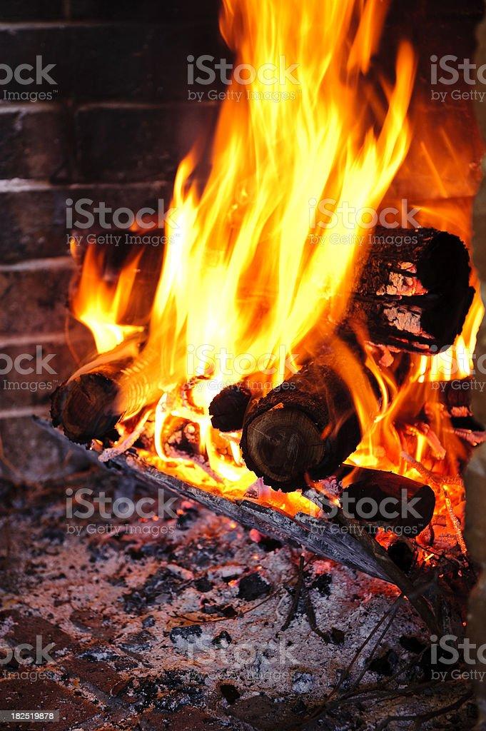 Fire burning logs fireplace hearth wood ash stock photo