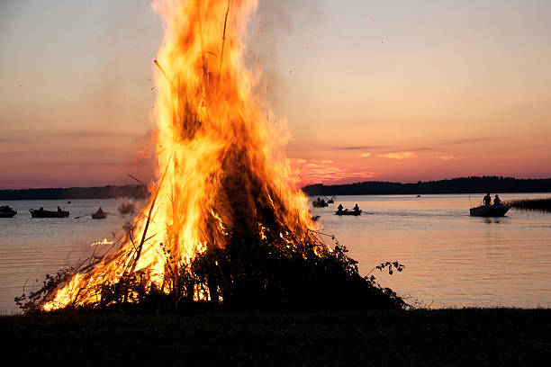 Fire burning on a midsummer Eve in Finland stock photo