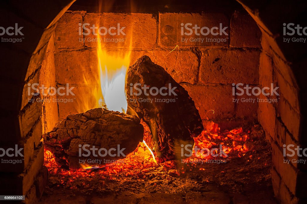 fire burns in a fireplace stock photo