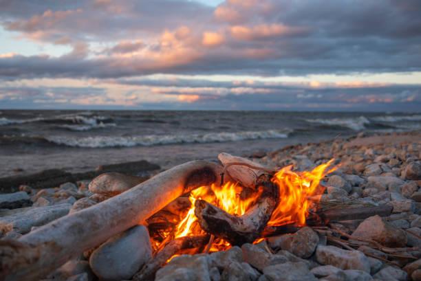 fire burns near the sea