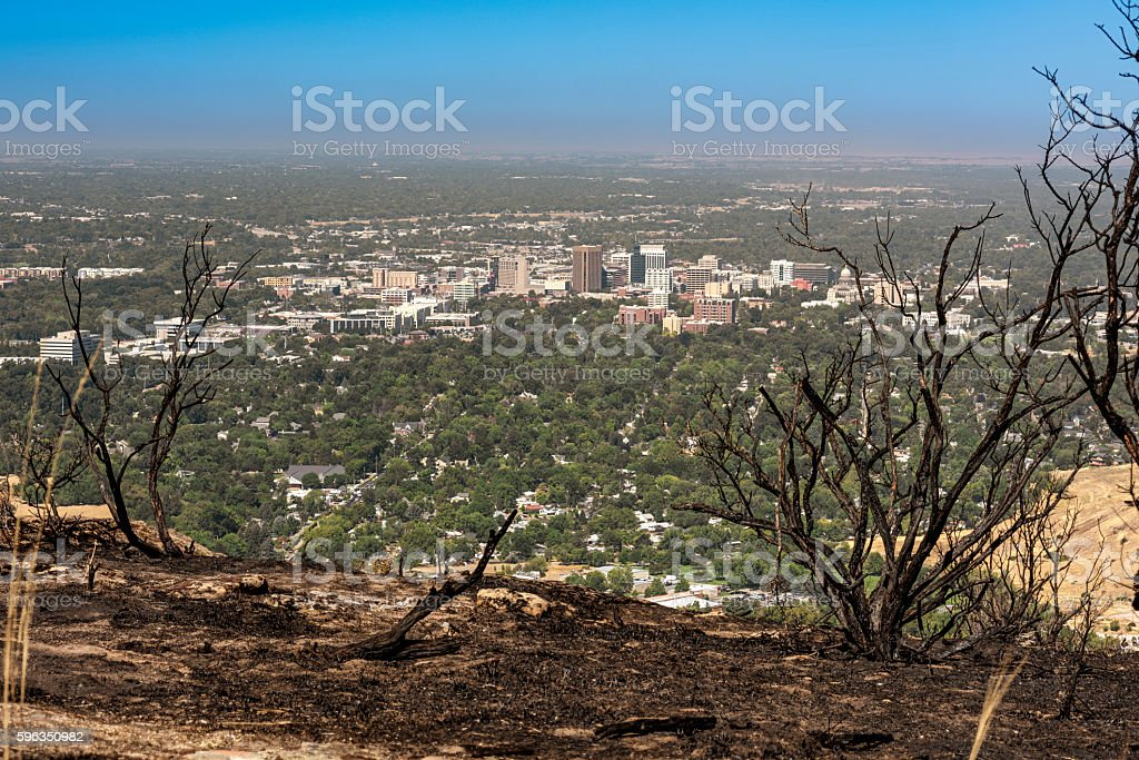 Fire burnt foot hills over Boise Idaho royalty-free stock photo
