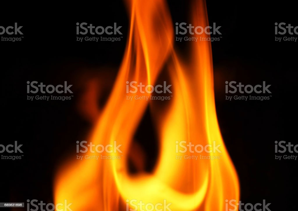 Fire close-up and on black background. royalty-free stock photo