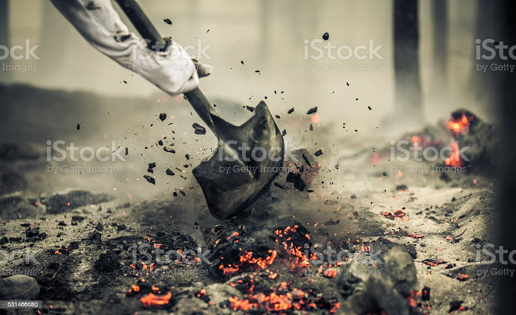 Fire coals during a firefighting operation stock photo