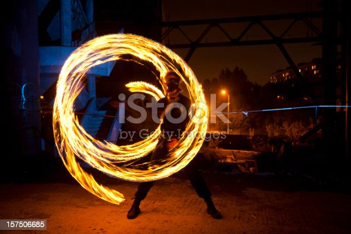 Fire performer in motion at night
