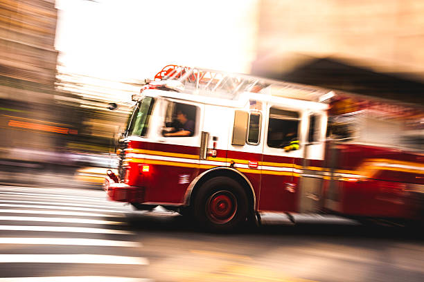 fire department truck in emergency - firefighter stock photos and pictures