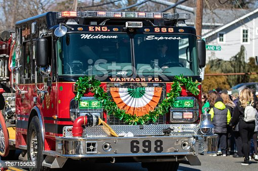 Wantagh, New York - March 17, 2019 : Fire Department vehicles driving in the first Annual St. Patrick's Day Parade down Wantagh Ave. Long Island