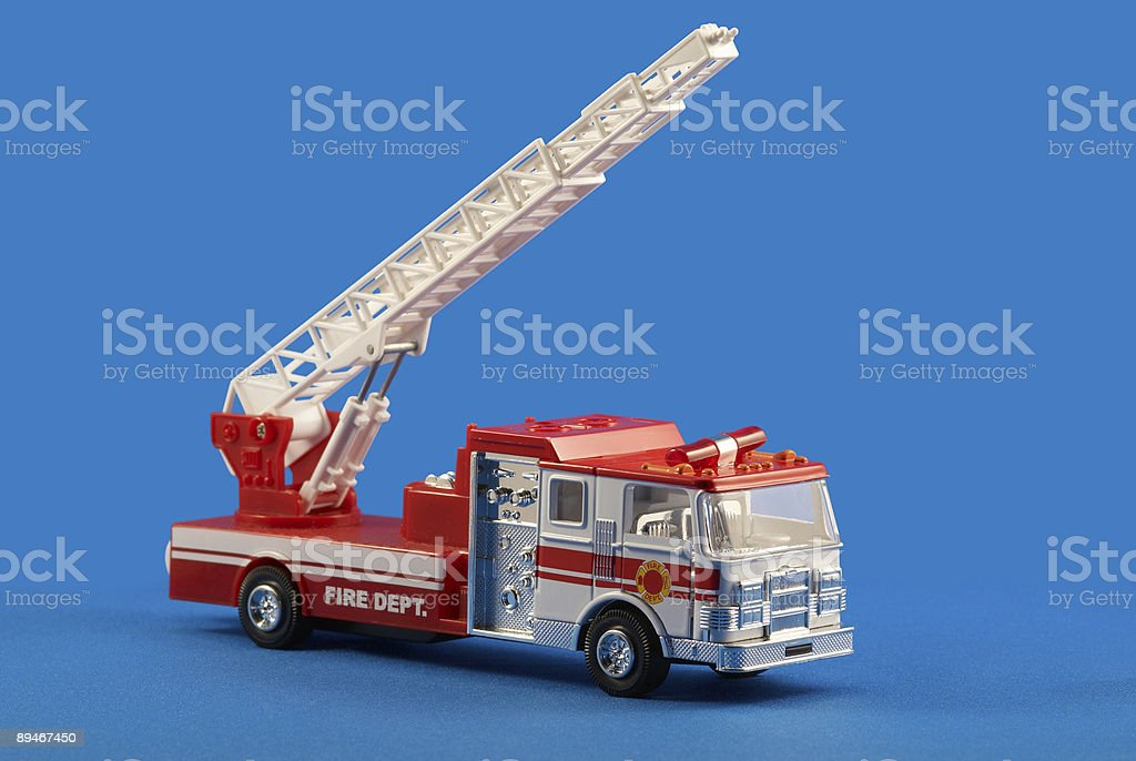 Fire dept car toy on blue royalty-free stock photo