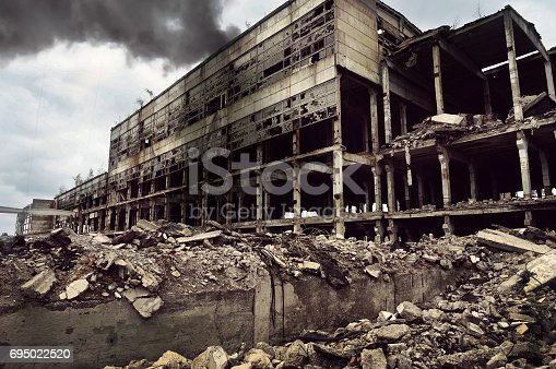 istock Fire destroyed the factory building 695022520