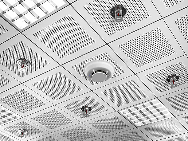 Fire detector and sprinklers Fire detector and sprinklers mounted on the suspended ceiling.Similar images: ceiling stock pictures, royalty-free photos & images